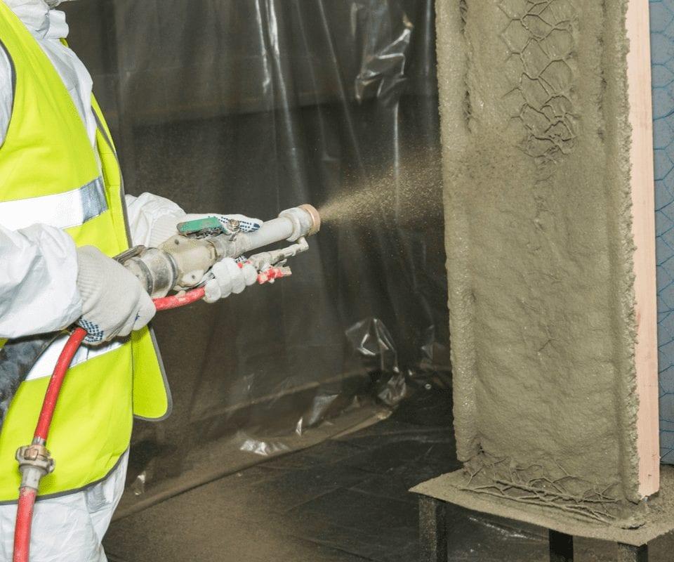 worker spraying concrete